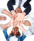 Smiling busines people with hands togather Stock Photo