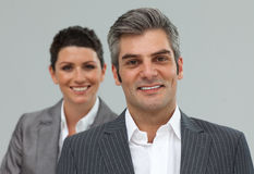 Smiling business associates in a row Stock Images