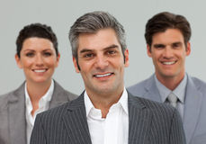 Smiling Business associates standing in a line Royalty Free Stock Photo