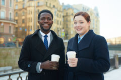 Smiling Business Colleagues with Coffee in Street stock photos