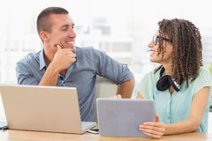 Smiling business colleagues discussing together Royalty Free Stock Photography
