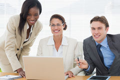 Smiling business colleagues with laptop in meeting Royalty Free Stock Photography
