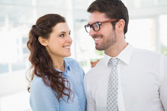 Smiling business colleagues looking each other Stock Image
