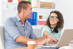Smiling business colleagues looking at each other Stock Image