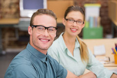 Smiling business colleagues in office Stock Photo
