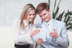 Smiling business couple looking at digital tablet screen.  stock images