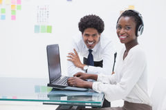 Smiling business coworkers using laptop Royalty Free Stock Images