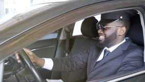 Smiling business driver sitting in luxury automobile, transportation service royalty free stock photo