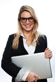 Smiling business executive with a laptop Royalty Free Stock Photo