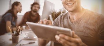 Smiling business executive using digital tablet Stock Photos