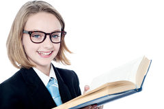 Smiling business girl holding a book Stock Photography