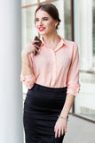 Smiling business girl is sending message by phone Royalty Free Stock Image