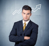 Smiling business guy with graph arrow Stock Photography