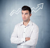 Smiling business guy with graph arrow Royalty Free Stock Image