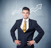 Smiling business guy with graph arrow Stock Image