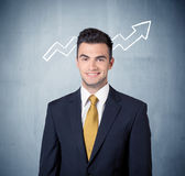 Smiling business guy with graph arrow Stock Photos