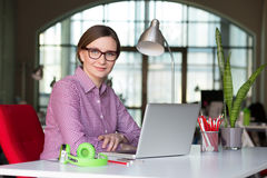 Smiling Business Lady in modern Digital Office Interior. Smiling Business Lady in smart casual Style Clothing working at modern Digital Office Interior Royalty Free Stock Photos
