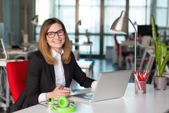 Smiling Business Lady in official clothing sitting at Office Table Royalty Free Stock Photo