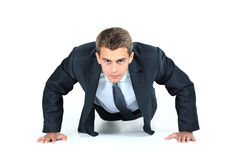 Smiling business man. Business man doing push-ups Stock Photos