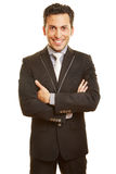 Smiling business man with arms Royalty Free Stock Photos
