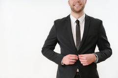 Smiling business man body side button up his black suit on white. Part of business man body side button up his black suit on white background; business concept Stock Images