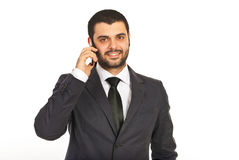 Smiling business man by cell phone Royalty Free Stock Images