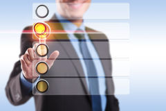Smiling business man choosing and pushing a button Royalty Free Stock Photos