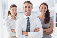 Smiling business man with colleagues Stock Photos