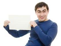 Smiling business man displaying blank card. Royalty Free Stock Photos