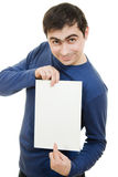 Smiling business man displaying blank card. Stock Image