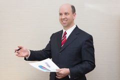 Smiling business man with document. Stock Photos