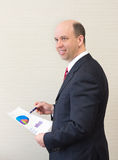 Smiling business man with document. Royalty Free Stock Photography
