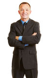 Smiling business man with his arms crossed Stock Images
