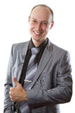 Smiling business man with his finger shows positiv Royalty Free Stock Photography