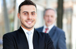 Smiling business man with his partner Royalty Free Stock Photography