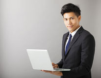 Smiling business man holding laptop Royalty Free Stock Photography