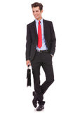 Smiling business man holding a suitcase stock photo