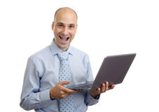 Smiling business man with laptop Royalty Free Stock Photography