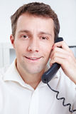 Smiling business man making phone Royalty Free Stock Images