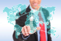 Smiling business man making worldwide connections Stock Images