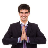 Smiling business man in namaste pose Royalty Free Stock Photography