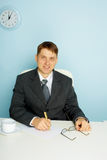 Smiling business man at office Stock Photo