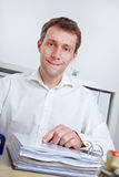 Smiling business man in office Royalty Free Stock Image