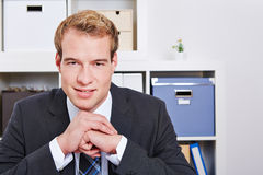 Smiling business man in office Stock Photography