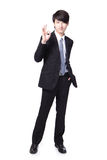 Smiling business man with okay gesture Stock Image