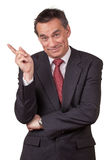 Smiling Business Man Pointing Left Stock Image