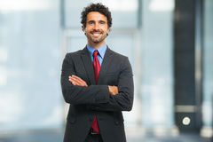 Smiling business man portrait in the office Royalty Free Stock Photography
