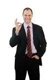 Smiling business man show ok isolated on white Royalty Free Stock Photo