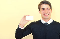Smiling business man showing a blank business card Stock Photography