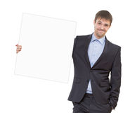 Smiling business man showing blank signboard Royalty Free Stock Photography